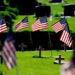 Flags fly for veterans in Lansing's Evergreen Cemetery this weekend. Four parades and six Memorial Day ceremonies or services are planned across Greater Lansing today.