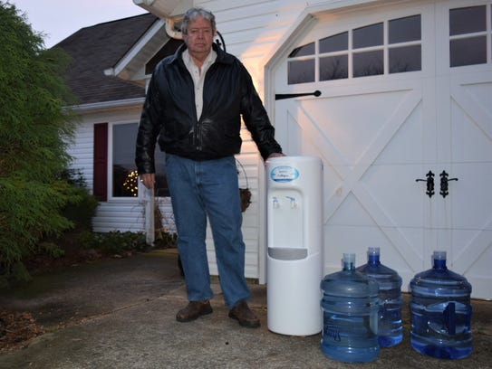 Robert Phillips, 70, is one of many Millsboro-area residents who opened their doors to a surprise water delivery the week of Nov. 27. The water, provided on behalf of Mountaire Farms, came with no instructions and no explanation.