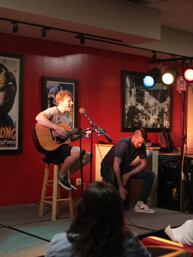 Student performs at Open Mic Night at the Student Life