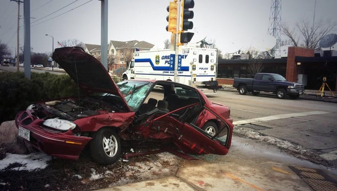 Multiple factors may have contributed to a crash that killed the driver of this Pontiac Grand Am on Saturday, Green Bay police said.