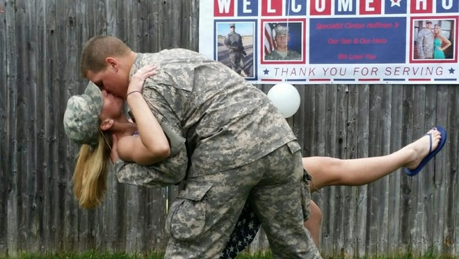 Army Specialist E4 Clinton Hoffman Jr. of Barnegat kisses Michelle Lombardi upon his return from Qatar.