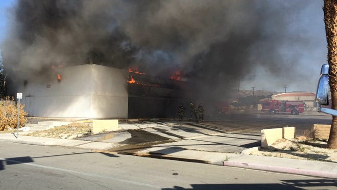 A fire destroyed a vacant commercial building at Palm Drive and Hacienda Avenue in Desert Hot Springs on Monday, March 14, 2016.