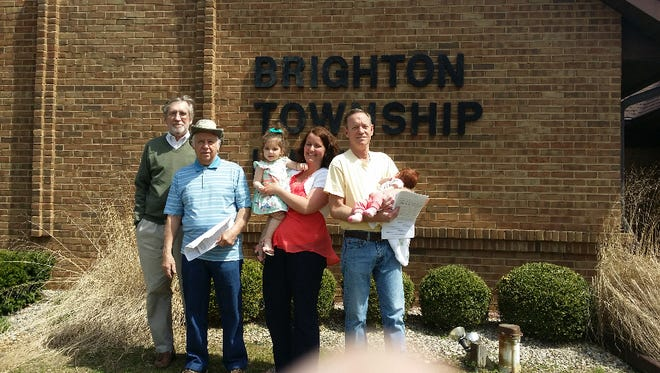 Four Brighton Township residents who have been vocal at public meetings decided to run for township offices themselves. (From left to right) Bob Potocki, Jim Sarna, Anna Chatten (her two young daughters are also pictured), and Mike Palmer stand outside of the township hall after filing candidate papers Monday afternoon.