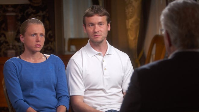 Russian whistleblower Yuliya Stepanova, left, and her husband Vitaly.