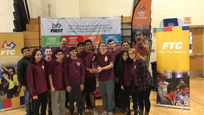 Wayne team the Patriots pose with one of their awards at FTC State Championships held Feb. 26.