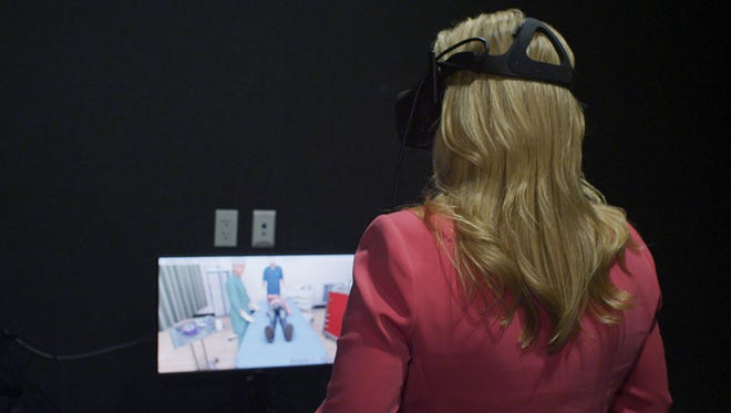 Jennifer Jolly practices hospital life-saving techniques using Oculus Rift.