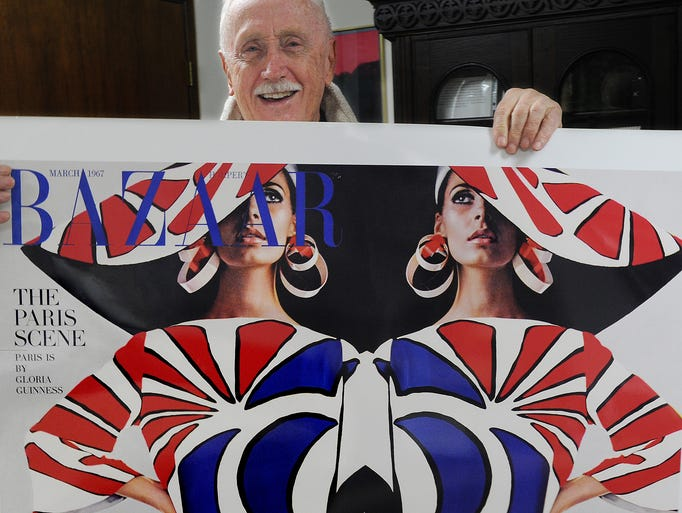 Fashion photographer Neal Barr displays a print of