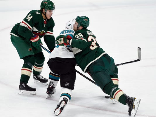 Minnesota Wild's Mikael Granlund (64), of Finland, and Nate Prosser (39) collide with San Jose Sharks' Logan Couture (39) during the first period of an NHL hockey game Sunday, Feb. 25, 2018, in St. Paul, Minn. (AP Photo/Hannah Foslien)