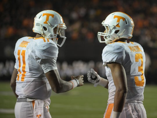 Tennessee quarterback Joshua Dobbs (11)  and Tennessee wide receiver Josh Malone (3) celebrate Malone's first-half touchdown catch in the game between Vanderbilt and Tennessee at Vanderbilt Stadium Saturday, Nov. 26, 2016, in Nashville, Tenn.