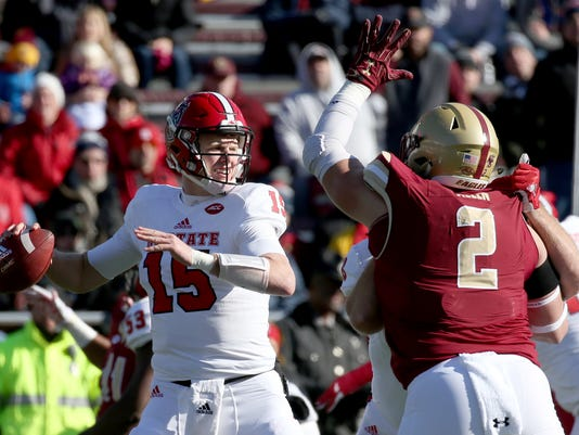 North Carolina State quarterback Ryan Finley (15) drops back to pass as Boston College defensive end Zach Allen (2) applies pressure during the first half of an NCAA college football game Saturday, Nov. 11, 2017, in Boston. (AP Photo/Mary Schwalm)