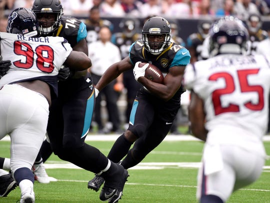 Jacksonville Jaguars running back Leonard Fournette (27) runs against the Houston Texans during the first half of an NFL football game Sunday, Sept. 10, 2017, in Houston. (AP Photo/Eric Christian Smith)