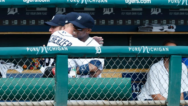 Austin Jackson receives a hug from  Max Scherzer after he lives the game in the seventh inning.