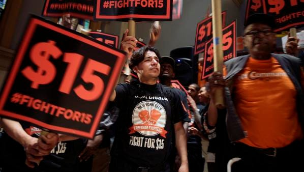 Demonstrators rally for a $15 minimum wage before a meeting last month of the state Wage Board in New York.