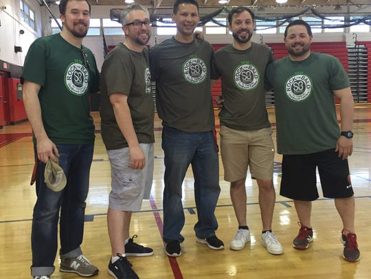 From left to right, the Woodbridge High School faculty and staff who shaved their heads to support children with cancer are Brian O'Halloran, Mike Switek, Glenn Lottmann, Dan Mortensen and Mike Monaco.