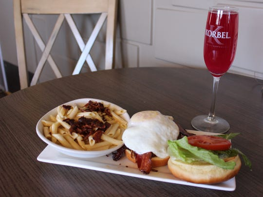 Prickly Pear Mimosa and Breakfast Burger served with Green Chile Mac and Cheese with jalepeño bacon at Salud! de Mesilla, 1800 Avenida de Mesilla.