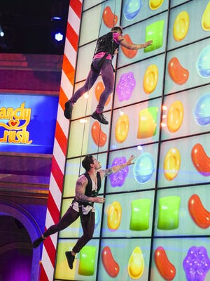 Two contestants try out the new 'Candy Crush' board.