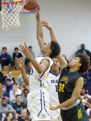 Male guard-forward Howard Fleming drives to the basket