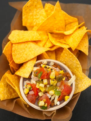 The Mayan Street Food's frijol colado (black bean dip) is made with black beans, chorizo, Chihuahua cheese, roasted corn and tomato salsa and is served with fried corn taco chips.  Feb. 22, 2018