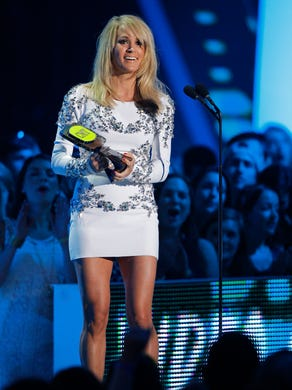 Carrie Underwood accepts the award for collaborative
