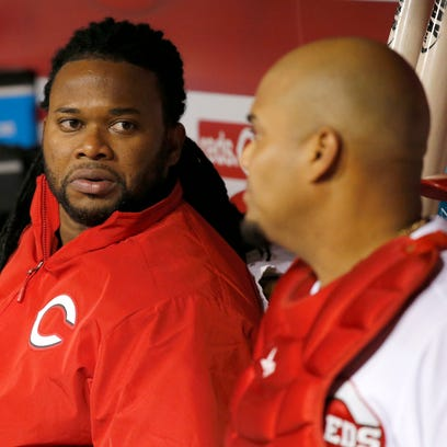 04282015 REDS-CUBS  Tue., April 28, 2015 CINCINNATI Cincinnati Reds starting pitcher Johnny Cueto (47), left, talks to Cincinnati Reds catcher Brayan Pena (29) in the dugout between the eighth and ninth innings during the game against the Milwaukee Brewers, Tuesday, April 28, 2015, at Great American Ball Park in Cincinnati. The Enquirer/Kareem Elgazzar