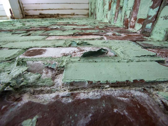 Discolored wood and peeling paint indicate where water has leaked through the roof of Memorial Auditorium in Burlington on Thursday, October 1, 2015.