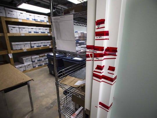 After it was determined in 2014 that now-former Colchester Police Detective Tyler Kinney had tampered with evidence in the department's evidence room, the chamber was sealed by the Federal Bureau of Investigation.  The tape is seen on Tuesday, November 3, 2015.