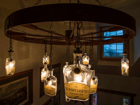 Raj Bhakta has renovated a 100-year-old barn in Shoreham, transforming it into a distillery for WhistlePig rye whiskey. A bottle-bedecked chandelier decorates a building else where on the farm. Seen on Wednesday, October 28, 2015.