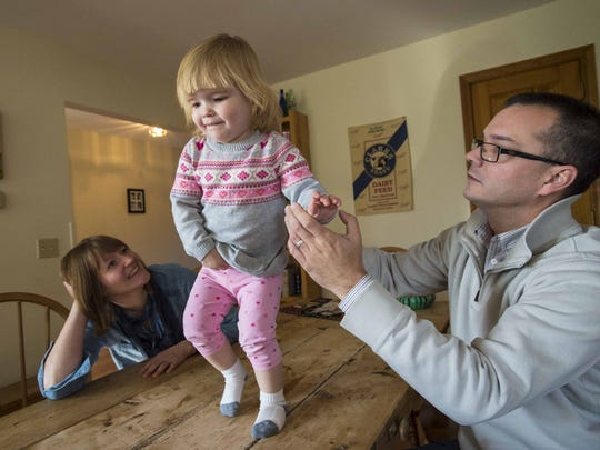 Tilly McCarthy with her parents Kristin and Brian at home in Swanton on Thursday, December 10, 2015. Tilly suffers from cystic fibrosis. The McCarthys are losing their local pediatrician, in part because of the low rate of Medicaid reimbursements. Four of eleven pediatricians in Franklin County are leaving their practices.