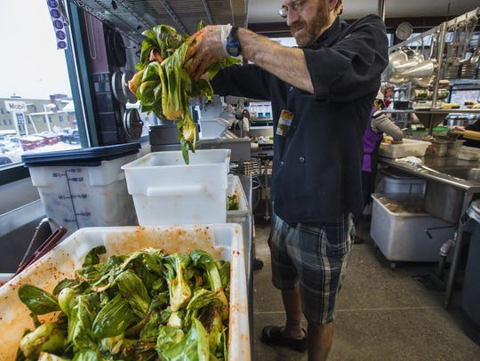 Chef Steven Obranovich prepares bok choi in the kitchen