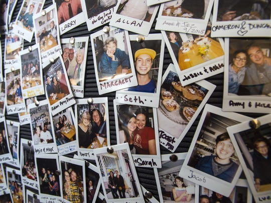 Customers' photos are collected on a wall at Down Home