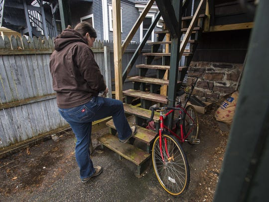Burlington housing inspector Kim Ianelli checks a cracked step at an apartment on Wednesday, February 3, 2016.
