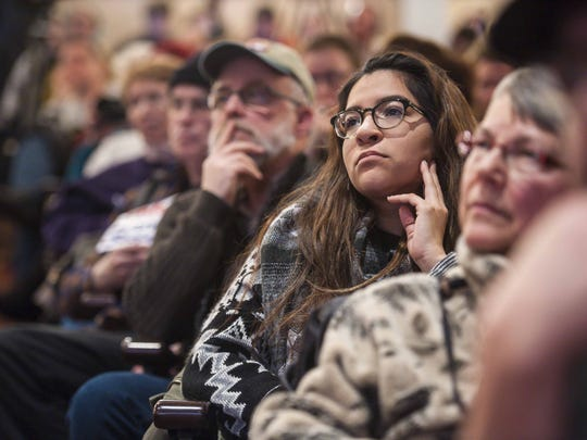 Audience members listen as Democratic presidential candidate Senator Bernie Sanders, I-Vt., speaks at a rally at the Palace Theater in Manchester, New Hampshire on Monday, February 8, 2016.