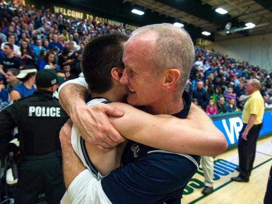 Burlington coach Matt Johnson hugs Josh Hale after Burlington defeated  Rice Memorial in the Division 1 boys state basketball championship in Burlington on Saturday, March 5, 2016.