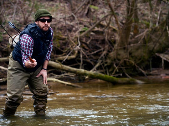Jason Konopinski uses his tenkara rod to precisely place his fly while fishing for trout in North Codorus Township.