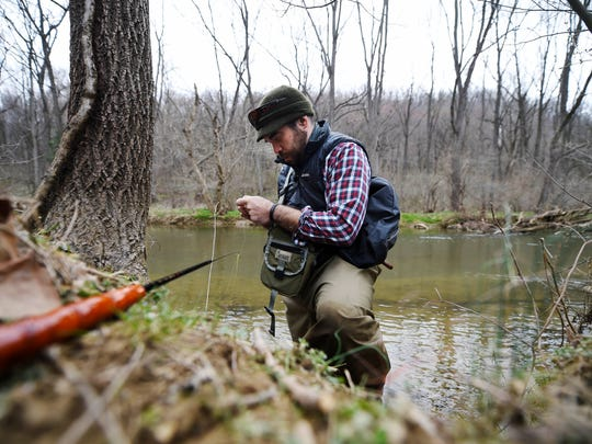 Jason Konopinski of Hanover prepares his tenkara rod to fly fish for trout on the west branch of the Codorus Creek in North Codorus Township Saturday, March 12, 2016.