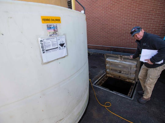 Tim Grover, chief operator for Burlington's wastewater system, explains how ferric chloride is used to reduce phosphorous at the city's main treatment facility on Friday, November 20, 2015.