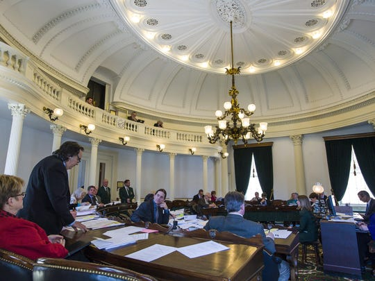 Sen. Anthony Pollina, P/D-Washington, left, explains details of a bill establishing a legislative ethics commission at the Statehouse in Montpelier on Tuesday.