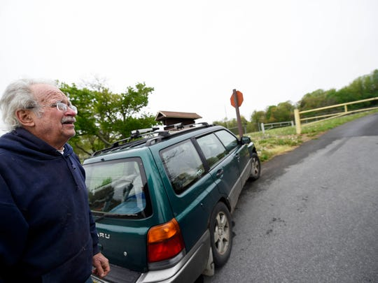 """Conrad Miziumski, whose property backs up Holtwood Park, stopped to see the closure of the park for himself. """"That's a precious area for us,"""" he said."""