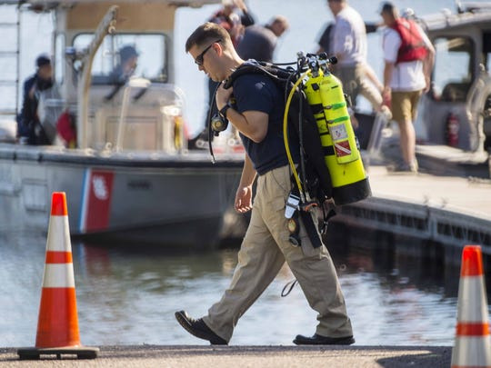 Rescue personnel prepare to resume their search for Rodney Dion on Malletts Bay in Colchester on Thursday, June 16, 2016. Dion was  missing after a collision between two motorboats Wednesday evening.
