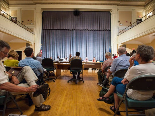 Alex Lavin speaks against the proposed Burlington Town Center redevelopment project during a meeting of the Burlington Planning Commission in Burlington on Wednesday, July 6, 2016.