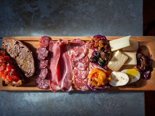 Antipastone featuring artisinal salumi, local cheeses, marmellata, house-preserved vegetables and bruschette at Sotto Enoteca in Burlington on Tuesday, July 26, 2016.