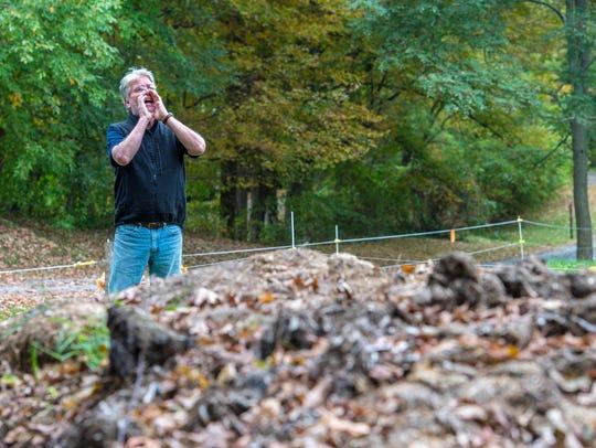 Steve Judge calls his cows near the manure pile at