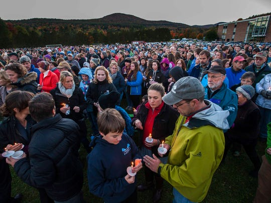 Community members gather for a vigil for five high school students killed in a head-on crash on I-89 held at Harwood Union Middle/High School in Duxbury on Monday, October 10, 2016.