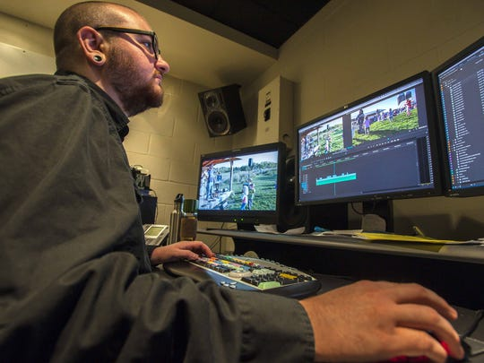 "Production Technician Holt Albee edits a Kickstarter video for a new ""Vermont is Kids"" program at the Vermont PBS studios in Colchester on Monday, October 10, 2016."