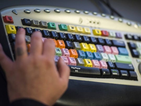 "Production Technician Holt Albee edits an episode of the new ""Innovate"" program at the Vermont PBS studios in Colchester on Monday, October 10, 2016."