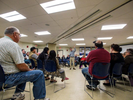 Residents listen as South Burlington's Director of