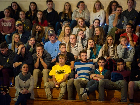 Students listen during a celebration of the lives of