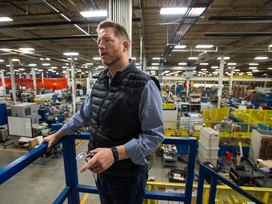 Dynapower Corporation President Adam Knudsen gives a tour of the company's manufacturing facility in South Burlington on Monday, November 7, 2016.
