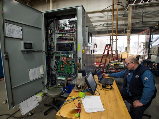 Jay Mead, an inverter technician at Dynapower Corporation in South Burlington, runs a test on a 1.5 megawatt bi-directional inverter on Monday, November 7, 2016.