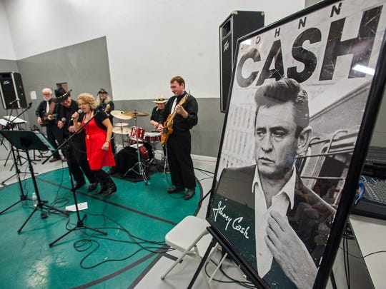 George Richard as Johnny Cash, left, and Marie Ragan as June Carter Cash, part of the Johnny Cash Tribute Show, perform for inmates at the Marble Valley Regional Correctional Facility in Rutland on Wednesday, November 30, 2016.